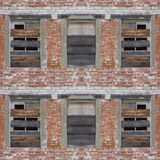 Seamless pattern of wooden window shutters. Seamless pattern for designers with old wooden window shutters on red brick wall royalty free stock photo