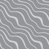 Seamless pattern with diagonal waves on grey background Royalty Free Stock Photo