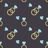 Seamless pattern with diamonds and luxury golden rings. Stock Photos