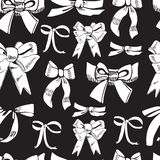 Seamless pattern with diferent white bows on black background. Hand drawn ink and inverted sketch stock illustration