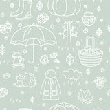 Seamless pattern with different autumn symbols. Linear nature icons background. Stock Image