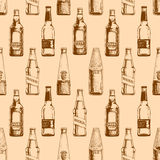 Seamless pattern with different beer bottles Royalty Free Stock Photo