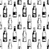 Seamless pattern with different beer bottles Stock Photography