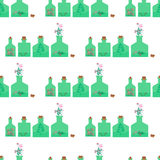 Seamless pattern with different bottles with various aromatic herbs inside. Royalty Free Stock Photography