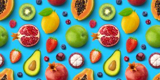 Seamless pattern of different fruits and berries, flat lay, top view, tropical and exotic texture. Seamless pattern of different fruits and berries, flat lay stock photos