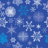 Seamless pattern of different hand drawn. Snowflakes on blue background. Vector illustration Royalty Free Stock Photo