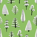 Seamless pattern with different hand drawn winter trees covered by snow on green background. Backdrop with cartoon snowy. Woodland. Vector illustration in stock illustration