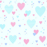 Seamless pattern with different hearts. Striped and polka-dotted. Pink, blue and purple colors. Good for packing romantic gifts Royalty Free Stock Images
