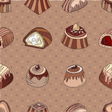 Seamless pattern with different kinds of chocolate candies - milk,dark,white chocolate. Royalty Free Stock Images