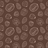 Seamless pattern with different nuts, whole and shelled. Walnuts, almonds, hazelnuts. Mix of nuts. Stock Image