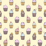 Seamless pattern with different type of capcakes Royalty Free Stock Photos