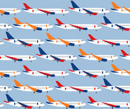 Seamless pattern with different types of passenger aircraft Royalty Free Stock Image