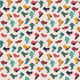 Seamless pattern with different types of shoes in flat style. vector illustration