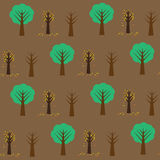 Seamless pattern with digfferent trees on the brown background Royalty Free Stock Photo