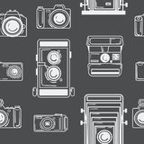 Seamless pattern with digital and retro cameras. Black white print for fabric. Seamless background for the web Stock Images