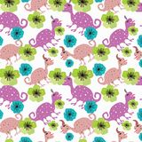 Seamless pattern with dinosaurs and flowers. royalty free stock photo