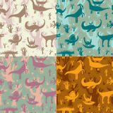 Seamless pattern dinosaurs. Set of 4 seamless patterns of different color with the dinosaurs Royalty Free Stock Image