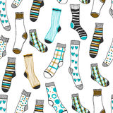 Seamless pattern of doddle socks on a white background Royalty Free Stock Photos