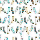 Seamless pattern of doddle socks on a white background. Clothing Stock Photos