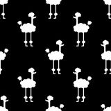 Seamless pattern. A dog on a black background. White dog on a black background royalty free illustration