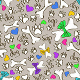 Seamless pattern of dog's paws and bones Stock Photos