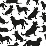 Seamless pattern with dog silhouettes. Royalty Free Stock Photos