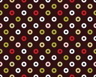 Seamless pattern of donuts. Bright, simple seamless pattern with donuts, abstract Royalty Free Stock Images