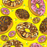 Seamless pattern of donuts on yellow Royalty Free Stock Photo
