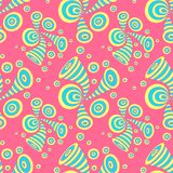 Seamless pattern with doodle abstract deformation circles in yellow blue on pink. Seamless pattern with doodle abstract deformation circles in Memphis style Stock Photos