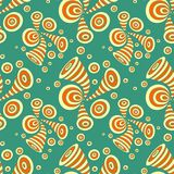 Seamless pattern with doodle abstract deformation circles in yellow orange on blue. Seamless pattern with doodle abstract deformation circles in Memphis style Royalty Free Stock Photography