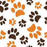Seamless pattern with doodle animal footprints. Royalty Free Stock Image