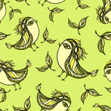 Seamless pattern with doodle birds in green Stock Image