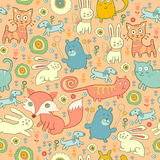 Seamless pattern of doodle cats, foxes, and rabbits Stock Photos