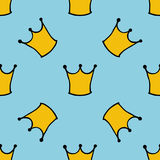 Seamless pattern with doodle crowns. Cute baby background for printing on textile, fabric, surfaces, patchwork, scrap-booking. Royalty Free Stock Photo