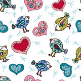 Seamless pattern with doodle cute birds. Decorative background with colorful doodle birds and hearts Stock Image