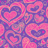 Seamless pattern with doodle decorative hearts. Royalty Free Stock Images
