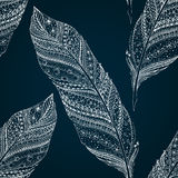 Seamless pattern with doodle feathers. Stock Photos