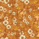 Seamless pattern with doodle flowers in orange Stock Image