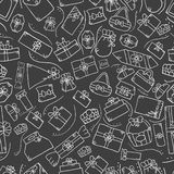Seamless pattern with doodle gift box on dark background Stock Photos