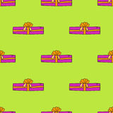 Seamless pattern with doodle gift box on green background. Royalty Free Stock Image
