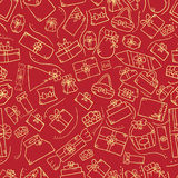 Seamless pattern with doodle gift box on red background. Cute  illustration Royalty Free Stock Photography