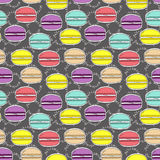 Seamless pattern , doodle hand drawn colorful macaroons on dark background, lettering in French, fabric, wallpaper Royalty Free Stock Images