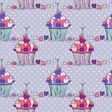 Seamless pattern with doodle hearts and cupcakes. Stock Photography