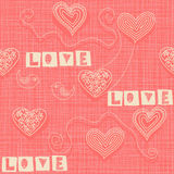 Seamless pattern with doodle hearts on texture background Royalty Free Stock Photo