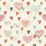 Seamless pattern with doodle hearts on texture background Stock Photography