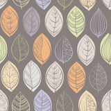 A seamless pattern with doodle leafs. On gray background. Vector illustration Stock Photo