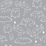 Seamless pattern with doodle owls and nature elements royalty free stock photos