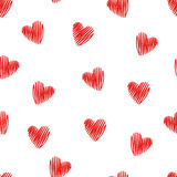 Seamless pattern with doodle red hearts. Stock Photos