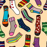 Seamless pattern of doodle socks for web design, prints etc. Repeating background can be copied without any seams Stock Images
