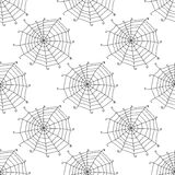 Seamless pattern with doodle spiderwebs. Vector Stock Images